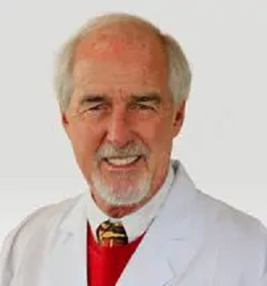 Image of doctor smiling wearing white lab coat