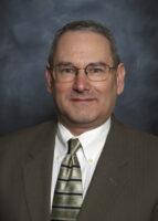 Headshot of male psychiatrist wearing glasses