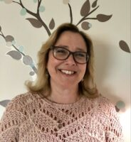 Female psychologist in glasses smiling