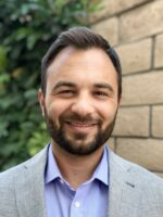 Headshot of male therapist with beard smiling